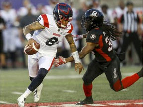 Alouettes Quarterback Vernon Adams Jr. eludes Redblacks' Deshawntee Gallon. Adams is the latest Montreal quarterback trying to fill the large shoes of all-time great ANthony Calvillo.