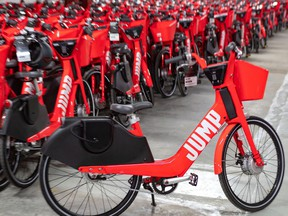 Jump's system is dockless, meaning users can deposit and pick up the bikes anywhere, as long as they are affixed to bike racks with the U-lock that comes with each bike.