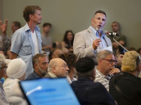 Pierrefonds-Roxboro Mayor Jim Beis, seen here speaking during consultations regarding Quebec's flood-zone map last July, will participate in a climate change/real estate conference set for Feb. 18, 2020.