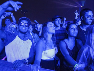 People enjoy the music of Marshmello on Day 1 of the ÎleSoniq electronic music festival at Parc Jean-Drapeau in Montreal on Friday, August 9, 2019.