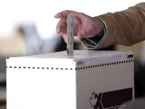 A voter casts a ballot in the 2011 federal election in Toronto on May 2, 2011.A pre-election chill has descended over some environment charities after Elections Canada warned them that discussing the dangers of climate change during the upcoming federal campaign could be deemed partisan activity.