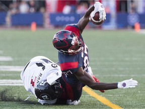 Montreal Alouettes' Eugene Lewis, right, is tackled by Ottawa Redblacks' Chris Randle at the one-yard line during the first quarter of their CFL football game in Montreal, Friday, August 2, 2019. The play was initially ruled a touchdown but revised to a tackle on review.