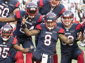 Alouettes quarterback Vernon Adams Jr., (8) celebrates with teammates after scoring a touchdown during first half CFL football action against the Ottawa Redblacks in Montreal, Friday, August 2, 2019.