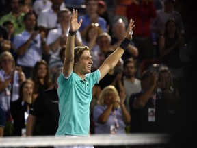Denis Shapovalov of Canada reacts after defeating Pierre-Hughes Herbert of France (not pictured) during the Rogers Cup tennis tournament at IGA Stadium in Montreal on Aug. 5, 2019.