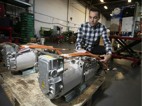 Effenco founder and president David Arsenault inspects electric motors to be shipped to France.