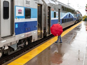 A passenger boards the train at Ahuntsic station on the Mascouche commuter line. Direct service to downtown from Mascouche will end once the REM comes online.