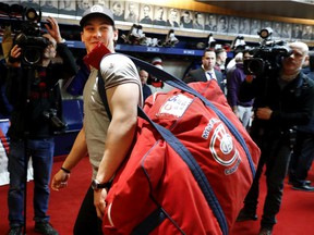 Canadiens forward Charles Hudoncarries his bag out of the locker room after speaking to the media as players cleared out their lockers at the Bell Sports complex in Brossard on April 9, 2018.
