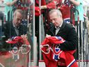 Canadiens Hall of Famer Guy Lafleur signs autographs for fans before alumni game in Calgary on Dec. 3, 2015.