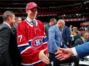 Defenceman Cale Fleury meets with Canadiens management team after being selected in the third round (87th overall) of the 2017 NHL Draft at the United Center in Chicago.