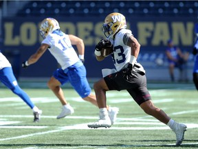 Andrew Harris gallops down the field during Winnipeg Blue Bombers practice at IG Field on Tues., Sept. 17, 2019.