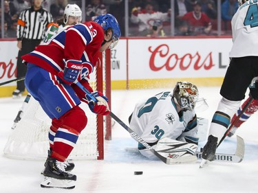 Montreal Canadiens Max Domi can't control the puck next to San Jose Sharks goalie Aaron Dell's net during first period of National Hockey League game in Montreal Thursday October 24, 2019.