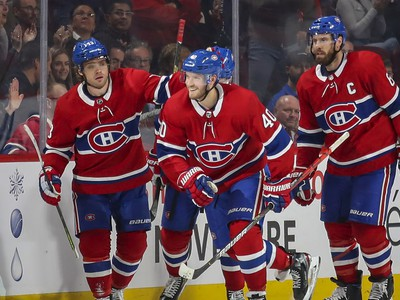 Montreal Canadiens Joel Armia, centre, skates to the bench with team-mates Max Domi, left, and Shea Weber after scoring goal against the San Jose Sharks during second period of National Hockey League game in Montreal Thursday October 24, 2019.
