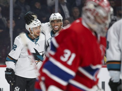 Montreal Canadiens Carey Price skates away as San Jose Sharks Kevin Labanc, left, is congratulated by team-mate Evander Kane after scoring goal during second period of National Hockey League game in Montreal Thursday October 24, 2019.