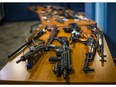 Toronto Police display some of the guns acquired following a gun buyback program earlier this summer.