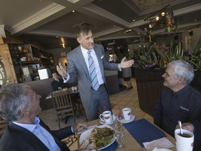 Maxime Bernier, leader of the PPC, speaks with people in a restaurant in Ste-Marie-de-Beauce, south of Quebec city, on Oct. 15, 2019