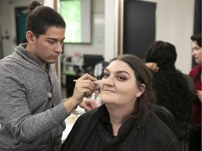 """Lisa McIntyre-Therrien gets makeup applied by  Carlos Christodoulou at LaSalle College on Thursday. """"I liked the beauty (session), the spa, the makeup,"""" McIntyre-Therrien  said. """"It's been nice. It's exciting."""""""