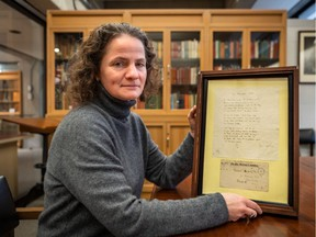 Mary Hague-Yearl, head librarian of McGIll University's Osler Library of the History of Medicine with  an original, in his hand, of the John McCrae poem In Flanders Fields  in Montreal on Monday November 4, 2019. Dave Sidaway / Montreal Gazette ORG XMIT: 63400 for schwartz story 1109 city flanders
