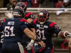 Alouettes running back William Stanback (31) is congratulated by teammate Kristian Matte (51) after scoring a touchdown in Montreal on Sunday, Nov. 10, 2019.