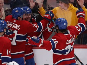 Montreal Canadiens Tomas Tatar (90) celebrates his goal  with teammates Nick Suzuki (14), Nick Cousins (21) and Phillip Danault (24) against the Columbus Blue Jackets during third period NHL action in Montreal on Tuesday November 12, 2019.