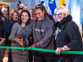 Mayor Valerie Plante and Putulik Qumak cut the ribbon at the Resilience Montreal day shelter and wellness centre in Westmount on Thursday November 14, 2019.
