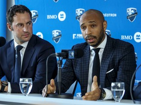 Montreal Impact sporting director Olivier Renard listens as French football legend Thierry Henry answers questions, at press conference introducing Henry as the team's new head coach in Montreal Monday Nov. 18, 2019.