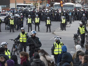 Hundreds of protesters are kettled by police on de Maisonneuve Blvd. E. after leaving Place Emilie Gamelin in Montreal Quebec, during a protest against the municipal bylaw requiring protesters to supply police with a route and not wear masks Friday, April 5, 2013.