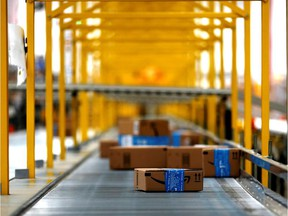 Packages make their way along a conveyor belt at Amazon's new warehouse near Mexico City.