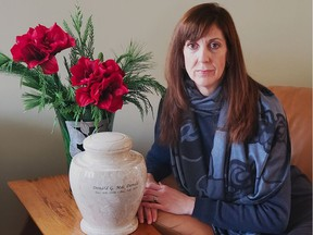Pamela MacDonald with the ashes of her late uncle, Donald G. MacDonald.
