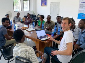 Samuel Mehenni was in Cap-Haitien, Haiti, leading a transit mapping project with the World Bank. He is shown here during his daily check-in with the project's local data collectors.