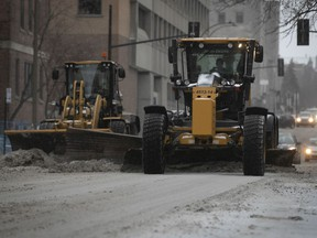 Snowplows make their way down Park Ave. on Monday, Dec. 30, 2019.