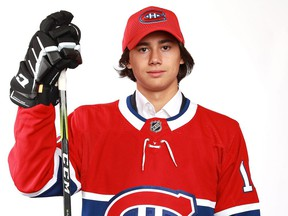 Russian defenceman Alexander Romanov poses for photo after being selected in the second round (38th overall) by the Montreal Canadiens at the 2018 NHL Draft at the American Airlines Center in Dallas.