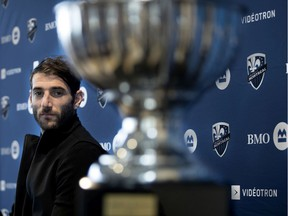 Montreal Impact Ignacio Piatti looks at his MVP trophy during a news conference in Montreal on Oct. 31, 2018.