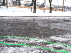 Green paint encircles bloodstains at the scene of Wednesday's stabbing in Laval's Parc Marc-Aurèle-Fortin.