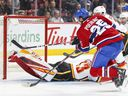 Montreal Canadiens Ryan Poehling fires the puck past Calgary Flames goalie David Rittich for his first goal of the season during third period of National Hockey League game in Montreal Monday January 13, 2020.
