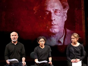 Left to right: Marcello Magni, Kathryn Hunter and Hayley Carmichael perform before an image of director and Stalinist victim Vsevolod Meyerhold in Why?, a new piece from Peter Brook and Marie-Hélène Estienne.
