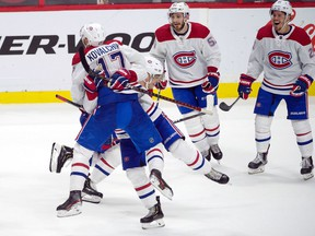 Canadiens' lIlya Kovalchuk celebrates with teammates after his goal in overtime against the Ottawa Senators at the Canadian Tire Centre in Ottawa on Saturday, Jan. 11, 2020.