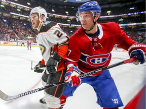 Montreal Canadiens' Ilya Kovalchuk tries to squeeze past Anaheim Ducks' Carter Rowney in Montreal on Feb. 6, 2020.