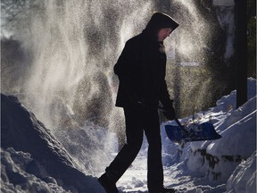 Marco Hedou heads for another shovelful of snow on Monkland Ave. in Montreal Feb. 8, 2020.