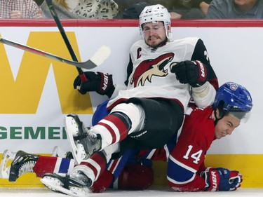 Arizona Coyotes Oliver Ekman-Larsson falls on Montreal Canadiens Nick Suzuki during first period of National Hockey League game in Montreal Monday February 10, 2020.