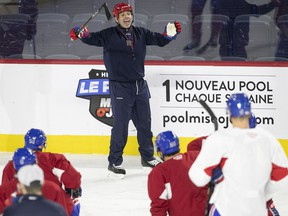 Rocket head coach Joel Bouchard talks to his players during practice in Laval on Feb. 18, 2020.
