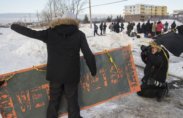 Eric St. Laurent yells at protesters blocking the CN railway tracks near the St-Lambert train station south of Montreal early Friday, February 21, 2020.