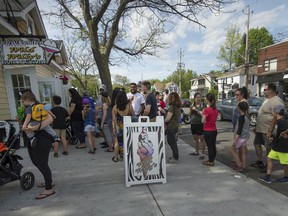 A summer day finds long lineups for ice cream outside Wild Willy's in Pointe-Claire. A corner lot next to the stand was slated for a condo project by Quorum Lakeshore Inc. until it was purchased by the city.