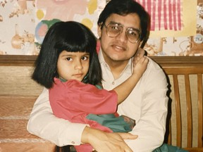 A young Fariha Naqvi-Mohamed sits in her father's lap in the kitchen of their home in Dollard-des-Ormeaux in 1989. Photo courtesy of Fariha Naqvi-Mohamed