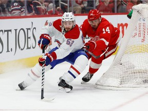 Canadiens defenceman Victor Mete skates with the puck chased by Wings' Robby Fabbri during first period Tuesday night in Detroit.
