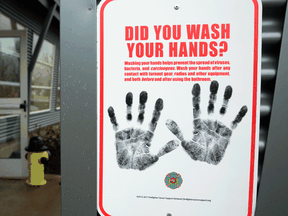 A sign reminding people to wash their hands outside a dormitory designated as a 2019 novel coronavirus quarantine site in North Bend, Washington.