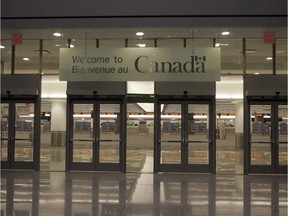 Pearson Airport's new Terminal 1 is pictured in Toronto Thursday, November 30, 2006. For Toronto Story by Peter Kuitenbrouwer Staff Photo: Brent Foster/National Post ADD: sign says Welcome to Canada - Canadian Customs and Immigration  /pws  // na111914-Refugees-Welfare //1109 na border ORG XMIT: POS2013022216575367  // 0116 na immig hfx ORG XMIT: POS1511070713030661