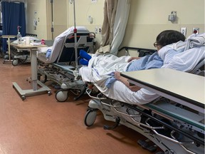 Patients in beds in the hallway in the emergency department of a Montreal area hospital Thursday February 27, 2020.