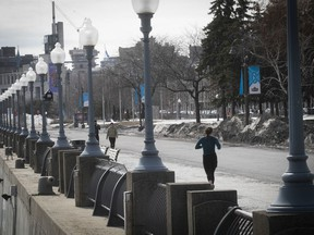 A jogger runs along a deserted path in the Old Port March 19, 2020.