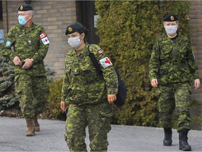 Canadian Armed Forces personnel leave a Laval seniors' residence after meeting with staff April 19, 2020.