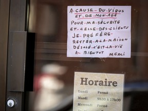 A sign hangs in the now closed Salon Denis, announcing the shop is closed until further notice as the city deals with the coronavirus pandemic in Montreal, on Friday, April 24, 2020. (Allen McInnis / MONTREAL GAZETTE) ORG XMIT: 64307